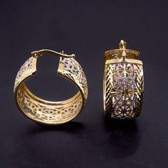 Orecchini traforati in 18mm bicolore galvanico. Disponibile in argento e in oro.