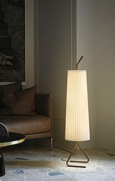The Fliegenbein SL Standing Lamp is the most recent addition to the Fliegenbein family, expanding the character and functional applications of the range. The new luminaire revises the proportions of the original Fliegenbein BL, with a truncated overall height and an elongated shade. The effect is of a lantern: the design's signature bent legs now peek out from under a silken pleated expanse that emits intimate, diffuse light. By pairing a modest size with bold visual gesture, Fliegenbein SL…