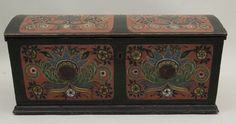 Norwegian trunk is held together by large, carefully executed dovetailing on the corners. Top and front panel are painted in Hallingdal style rosemaling. Side panels and back painted solid red. Interior is unpainted.