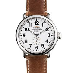 The Runwell 47mm watch featuring white dial and Horween leather strap is powered by a Swiss quartz Argonite 1069 movement and hand-assembled in Detroit.