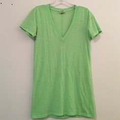 Brand new, never worn PINK Victoria Secret tee Brand new, never worn PINK Victoria Secret v-neck tee in lime green. In perfection condition! PINK Victoria's Secret Tops Tees - Short Sleeve