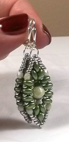 Beaded handwoven earrings with Czech glass beads and seed beads. The ear wires are silver plated. Earrings measure 2 inches overall. Thank you for visiting my Etsy shop! ♥♥♥♥♥♥♥♥♥♥♥♥♥♥♥ FREE SHIPPING TO ANY U.S. ADDRESS ♥♥♥♥♥♥♥♥♥♥♥♥♥♥♥ Beth Bonneville BeBo Jewelry Designs