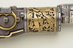 """"""" An ornate 6 shot wheel-lock revolving musket decorated with gold, silver, ivory, and bone. Originates from Russia, 16th century, possibly restored or added onto in the 18th or 19th century. """""""