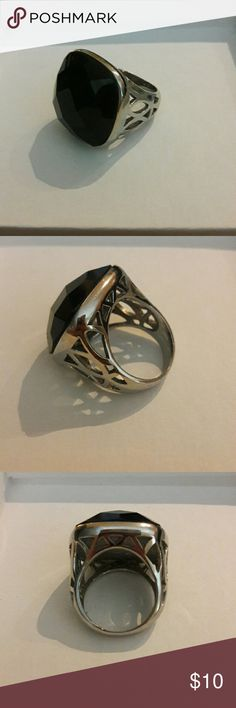 Black and Silver size 9 ring Black and Silver size 9 ring. Black fantasy stone. Beautifull details on the side. Jewelry Rings