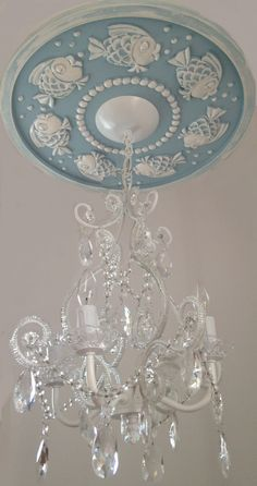 Nautical Ceiling Medallion by Marie Ricci. Shown in powder blue distressed with 4 arm chandelier. www.mariericci.com