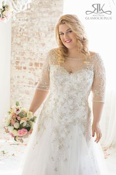 Brand: Glamour Plus Collection Style: Acacia Style Code: 5830T Fabrics: Embroidered tulle/Satin/Beading Colors available: Ivory/Silver Champagne/Silver Back opening options: Lace Up Zipper Sizing: 12-44
