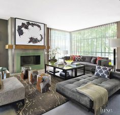 For the living room, designer and homeowner Erik W. Kolacz grouped together Joseph Jeup chairs from Holly Hunt in a Barbara Barry textile for Kravet, a daybed in an Edelman Leather material, and a custom sofa fabricated by Bolier. Living Room Images, Living Room Grey, Home Living Room, Living Area, Living Spaces, Grey Interior Design, Design Interiors, Custom Sofa, Loft Design