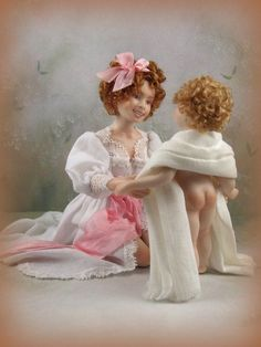 This miniature porcelain doll is an adult collectable and should under NO circumstances be given to a child . This auction is for two porcelain dolls in 1:12th scale .