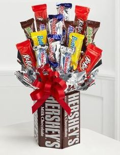 Candy bar bouquet - could also put in some of the M flowers