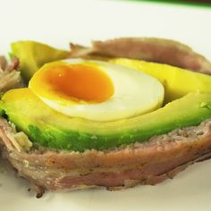 Avocado is one of the most nutritious foods in the world, rich in omega-3 fatty acids and many more. If you want to make the most of its wonderful flavor, don't limit yourself to salads – there are many other ways to cook it! Here is a simple idea to get you started:  bacon wrapped avocado, filled with soft boiled egg, and cooked in the oven.