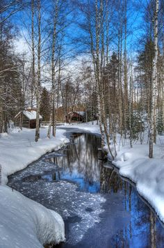 Frozen river in Vesilahti, Finland. There's also an old mill in the background.