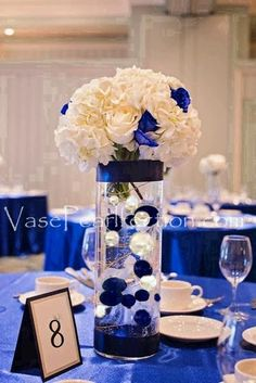 Royal Blue Wedding Decor 25 Breathtaking Wedding Centerpieces In Royal Blue Wedding Decorations, Blue Wedding Centerpieces, Quince Decorations, Quinceanera Decorations, Vase Decorations, Centerpiece Ideas, Elegant Centerpieces, Silver Decorations, Centerpieces For Sweet 16