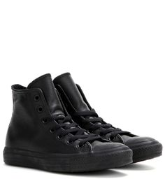 Converse - mytheresa.com exclusive Chuck Taylor All Star leather high-top sneakers - The iconic Converse Chuck Taylors are at their chicest in this all-black leather style. Slip them on with a tailored trouser and a cashmere sweater for a cool juxtaposition of sartorial staples. seen @ www.mytheresa.com