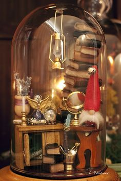 Life in a bell jar. Amazing. Check out her blog. You will have a great time browsing.