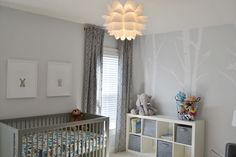 I am drawn to the grey walls and cute pictures above the crib