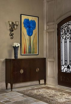 Clean lines of cabinet and painting create beautiful contrast to millwork, iron door and stone floor for a grand entrance. Toby Sneider - West Bloomfield, MI