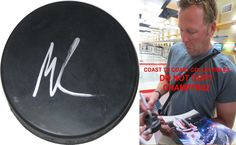 Martin Brodeur, St Louis Blues, New Jersey Devils, Canada, Signed, Autographed, NHL , Hockey Puck , a COA with the Proof Photo of Martin Signing Will Be Included