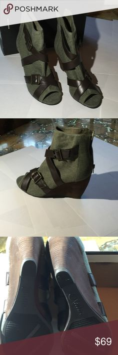 MIA Wedge Heel Bootie MIA Denim and leather Bootie.  Ultra stylish with criss cross straps and buckles in just the right places for a little extra spice.  Wedge heel. Zippered back.  Never worn.  Take it home today!...may not be here tomorrow!!  100% man made. Mia Shoes Ankle Boots & Booties