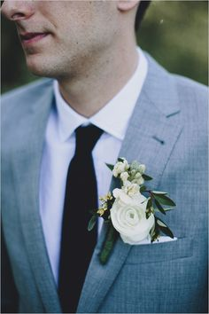 white and green boutonniere #groomsstyle #groomlooks #graysuite http://www.weddingchicks.com/2014/01/13/eclectic-midwest-wedding/