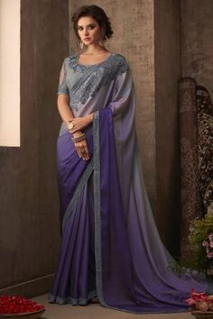 Grace elegance in this stunning grey saree with border. It is enhanced by a fully embellished blouse with a round neck. It drapes beautifully because of dual tones of lilac and grey running throughout the saree. Chiffon Saree, Silk Chiffon, Grey Saree, Blue Saree, Purple Fabric, Purple Ombre, Party Wear Dresses, Party Wear Sarees, Bridal Dresses