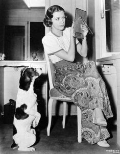 0 eleanor powell putting making up with dog looking at her