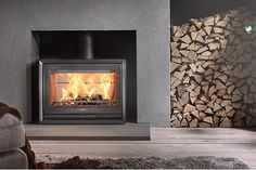 The low Contura enables you to place your fireplace at floor level, either freestanding or inside an existing masonry chimney (the stove in the illustration has a fire-rated constructional hearth). The Contura 330 is availab Wood Stove Hearth, Stove Fireplace, Best Wood Burning Stove, Fireplace Showroom, Freestanding Fireplace, Hygge Home, Log Burner, Kiln Dried Wood, Hacks