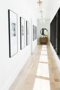 Natural light in a hall way with beautiful black and white family photos in over-sized frames with mats.
