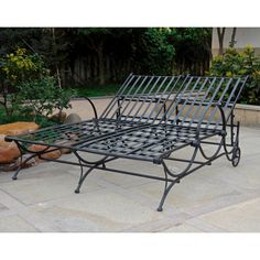 Enjoy relaxing outdoors with a friend or partner when you both lay back in this comfortable double chaise lounge. The sturdy iron frame provides secure support, and the chair is adjustable, so you can tailor it to your preferred angle.
