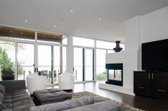 living rooms with window walls | ... with Glass Walls Connecting Home Interiors with Outdoor Living Spaces