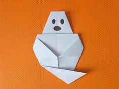 Learn how to make a simple origami paper ghost to use as an origami Halloween decoration. Follow these simple step by step origami instructions!
