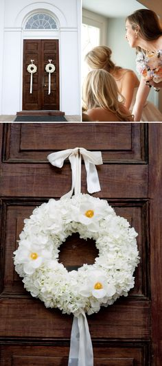 White floral door wreath for the wedding ceremony - so pretty! Photo by Leigh Webber.