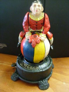 Mechanical clown cast iron money box . Clown swings around and stands on his head.