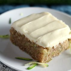 Soft zucchini cake frosted with a rich, tangy cream cheese frosting - the best way to eat zucchini this summer! Soft zucchini cake frosted with a rich, tangy cream cheese frosting - the best way to eat zucchini this summer! Zucchini Bars, Easy Zucchini Bread, Zucchini Bread Recipes, Banana Bread Recipes, Zucchini Soup, Zucchini Spaghetti, Vegan Recipes, Just Desserts, Delicious Desserts
