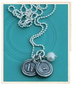 """These little initials are the perfect size! Each one is hand sculpted with fine silver and measures about 1/2"""" across."""