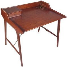 Danish Teak Writing Desk by Svend Madsen | From a unique collection of antique and modern desks and writing tables at http://www.1stdibs.com/furniture/tables/desks-writing-tables/