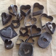 Collection of old heart shaped cookie cutters and molds