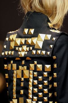Stud – black jacket with gold studs ​