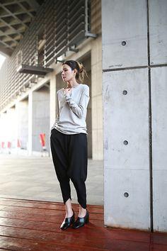Get this look: http://lb.nu/look/8241993  More looks by Miriam Mibao: http://lb.nu/miriammibao  Items in this look:  Miyuti Harem Pants, Celine Puppy   #casual #minimal #street