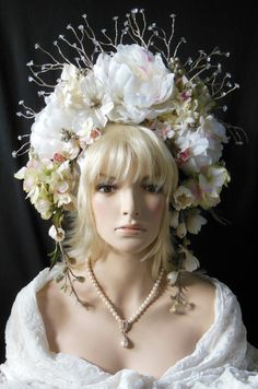 Beautiful Floral Mimsy Crown for Wedding or Fairy Princess. Colors are White, pale pink and pale yellow. Branches have faux ice at end of the branches. If you have any questions, feel free to ask