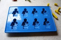 Lego Party: mini figure crayon mold (can be purchased on ebay); Break up crayons and put one crayon into each cavity.  Bake in the oven at 250 for about 8 to 10 minutes.  When it is all melted, take it out and put it either in the fridge if you are in a hurry to unmold them and make more or just let them sit out until the cool and harden.  Be  careful when unmolding the crayons, the heads break off if you don't unmold them carefully.