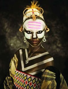 - We've seen numerous interpretations of the tribal theme in fashion, but the photography by Herring & Herring for D Mode Magazine is on a trib. Cara Tribal, Tribal Face, We Are The World, People Around The World, African Beauty, African Art, Black Is Beautiful, Beautiful People, Art Afro
