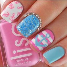 Anchors away with this cute blue glitter nail art design with baby pink, baby blue and white polishes.