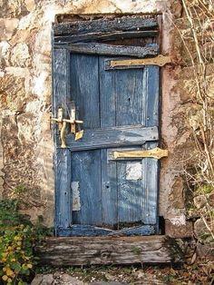 A very old door painted in blue ; the boards are roughly disjoint ; metal parts were painted yellow. - Photograph La vieille porte bleue by Georges Dubois Cool Doors, The Doors, Unique Doors, Entrance Doors, Doorway, Windows And Doors, Knobs And Knockers, Door Knobs, Door Handles