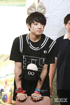 BTS jungkook~~~to me Jungkook is an adorable little kid. Nope I haven't been able to get past the fact that he is so young...buuut he's so damn cute I want to pinch his cheeks lol^^