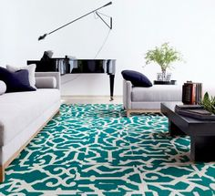 Give your living room a little chic lovin' with our Lasting Greatness carpet squares, in teal & bone.