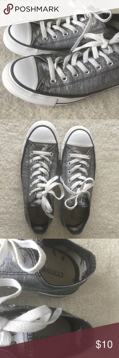 Silver Metallic Converse All-Star Sneakers Low-Top Converse with a silver metallic print. Have been worn. There is some fabric tearing on the inside heels (photo 3), but the rest of the shoes are in good condition. Converse Shoes Sneakers