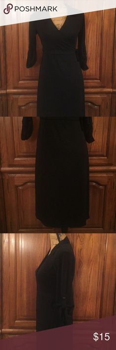 "Old Navy Maternity Black Wrap Dress Size small made of 92% polyester and8% spandex. Roll tabbed 3/4 sleeves. It measures approximately 18.5"" flat underarm to underarm and measures approximately 38"" long measured from shoulder to hem. Old Navy Dresses"