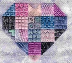 heart needlepoint sampler with sponge painted background