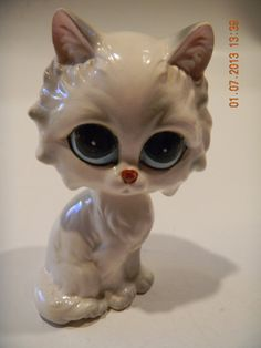 Vintage big-eyed white pity kitty figurine..sometime between the 70s and 80s I think..adorable. 12.99, via Etsy.
