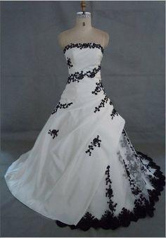 Google Image Result for http://i00.i.aliimg.com/wsphoto/v0/346543446/white-and-black-embroidery-wedding-dress-ASB3280.jpg